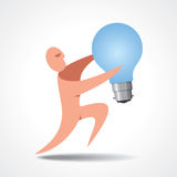 A man holding a light bulb. Its quite large compared to him, but he obviously wants to state he has a good idea Royalty Free Stock Image