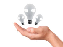 Man holding light bulb. success in business Stock Photography