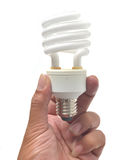 Man holding a light bulb on a white Stock Photo