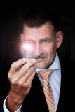 Man holding a lightbulb Royalty Free Stock Image