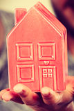 Man holding little red house, household concept Royalty Free Stock Photos
