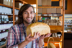 Man holding a loaf of bread Royalty Free Stock Photography