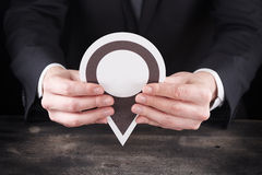 Man holding location icon in hands Stock Photo