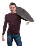 Man holding longboard in his hand Stock Photo