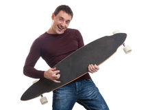 Man holding longboard in his hand Stock Photography