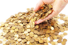 Man holding a lot of money. Hand keeping full of coins Stock Photography