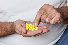 Man holding a lot of pills Stock Photography