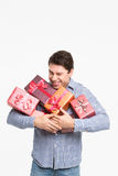 Man holding a lot of presents Stock Photos