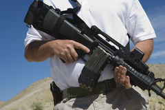 Man Holding Machine Gun At Firing Range Royalty Free Stock Images