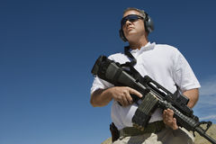 Man Holding Machine Gun At Firing Range Royalty Free Stock Photos