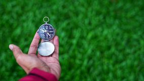 Man holding a magnetic compass Royalty Free Stock Image