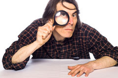 Man holding a magnifying glass Royalty Free Stock Photos