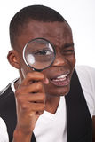 Man holding a magnifying glass Royalty Free Stock Images
