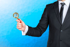 Man holding magnifying glass Royalty Free Stock Photos