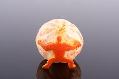 Man holding mandarin Royalty Free Stock Image