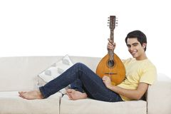 Man holding mandolin and smiling Stock Photography