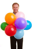 Man holding many balloons Royalty Free Stock Photos