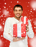Man holding many gift boxes Royalty Free Stock Photography