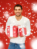 Man holding many gift boxes Stock Images
