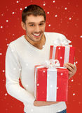 Man holding many gift boxes Stock Photo