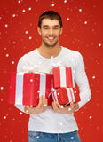 Man holding many gift boxes Stock Photos