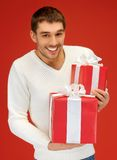 Man holding many gift boxes Royalty Free Stock Images