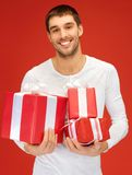 Man holding many gift boxes Royalty Free Stock Image