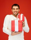 Man holding many gift boxes Stock Image