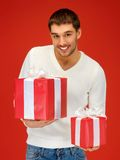 Man holding many gift boxes Stock Photography