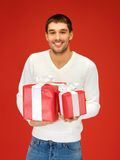Man holding many gift boxes Royalty Free Stock Photos