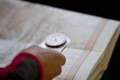 A man holding a map and compass, close up Stock Images