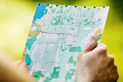Man holding a map  in his hand. Royalty Free Stock Photo