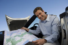 Man Holding Map While Sitting In Car Stock Images