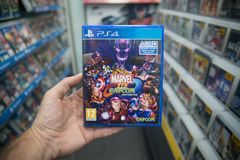 Man holding Marvel vs. Capcom infinite videogame on Sony Playstation 4 console in store. Bratislava, Slovakia, october 2 2017: Man holding Marvel vs. Capcom Stock Photography