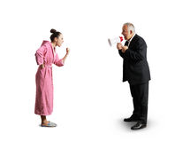 Man holding megaphone and screaming. Senior men in suit holding megaphone and screaming at angry women in pink dressing gown. isolated on white background Royalty Free Stock Photos