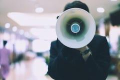 Man holding a megaphone shouting turn. Man holding a megaphone shouting turn in hospital stock image