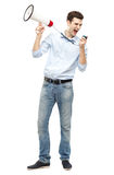 Man holding megaphone. Young man shouting through megaphone Royalty Free Stock Photos