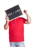 Man holding message written on a blackboard. Man holding Yes I Can message written on a blackboard Royalty Free Stock Photography