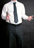 Man holding a microphone Royalty Free Stock Photography