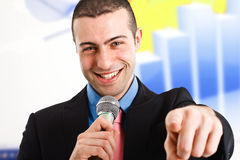 Man holding a microphone stock images