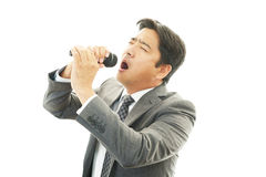 Man holding microphone Royalty Free Stock Images