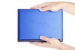 Man Holding a Mini Netbook Stock Images