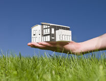 Man holding a miniature house Stock Photos