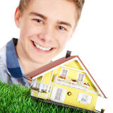 Man holding a miniature house Stock Image