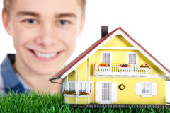 Man holding a miniature house Stock Photo