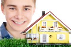 Man holding a miniature house Stock Photo