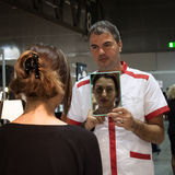 Man holding a mirror at Weekend Donna 2013 in Milan, Italy Royalty Free Stock Photography