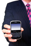 Man holding mobile close up. Man holding a mobile phone organiser towards camera, screen has a clipping path to add your own message or image. The device has Stock Image