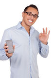 Man holding a mobile giving a perfect gesture Stock Photography