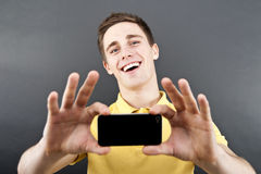 Man holding mobile phone Stock Photos